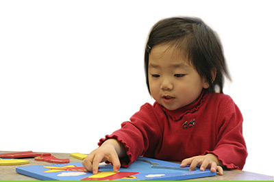 Toddler-with-Puzzle-white-bkgd
